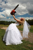 Crazy bride with red chainsaw — Stock Photo