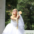 Funny bride in park — Stock Photo