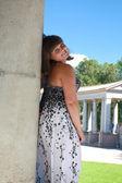 Pretty brunette woman in park — Stock Photo