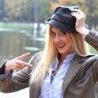 Blonde woman in autumn park — Stock Photo