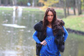 Woman near lake in autumn park — Stock Photo