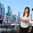 Two businesswomen and office building — Stock Photo