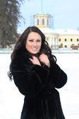 Happy brunette woman in park — Stock Photo