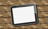 Tablet pc on wood — Stock Photo