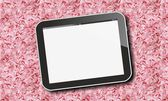 Tablet pc on pink flower leaves pattern — Stock Photo