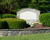 Blank sign of the subdivision entrance — Stock Photo