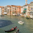 Tourists traveling by gondolon Grand Canal in Venice, 2012. — Stock Photo #15434061