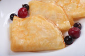 Fried pancake with cherries — Stock Photo