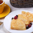 Fried pancakes with fruit — Stock Photo