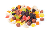 A mixture of dried fruits on a white background — Stock Photo