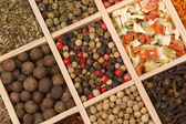 Set of spices in a wooden box — Stock Photo