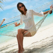 Girl in hammock on shores of azure oce(Maldives - Lhaviyani Atoll) — Stock Photo #30093241