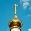 Church cross on the sky background (closeup) — Stock Photo #30499467