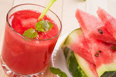 Fresh watermelon juice with pieces of fruit — Stock Photo