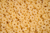 Pasta in the form of stars - background — Photo