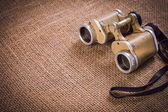 Old German military binoculars on canvas background — Stock Photo