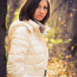 Portrait of a girl in the autumn forest — Stok fotoğraf