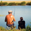 Grandfather and granddaughter on a fishing trip — Stock Photo #36505781