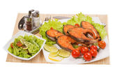 Baked trout with vegetables on a white background — Stock Photo