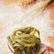 Stock Photo: Fresh tagliatelle on wooden table