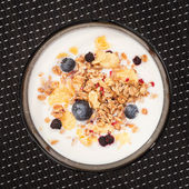 Muesli with yogurt and fresh blueberries. Top view — Stock Photo