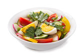 Fresh vegetable salad with eggs on a white background — Stock Photo