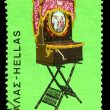 A stamp printed in Greece shows a barrel organ - Foto Stock