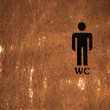 Stock Photo: Men Toilet Sign on wooden door