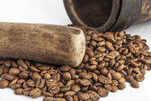 Mortar and pestle with coffee seeds — Stock Photo