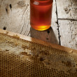 Honeycomb with fresh honey in a vase on wooden table. — Stock Photo