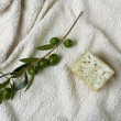 Handmade olive soap with olive branch and a towel. — Stock Photo