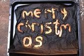 Merry christmas cookies in pan — Stock Photo