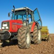 Agricultural tractor sowing seeds — Stock Photo
