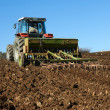 Agricultural tractor sowing seeds — Stockfoto #35883663
