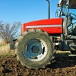 Agricultural tractor sowing seeds — Stockfoto