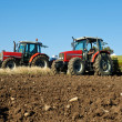 Agricultural tractor sowing seeds — Stock Photo #36712197