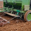 Stockfoto: Agricultural tractor sowing seeds