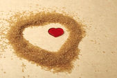 Valentines Day, heart made of brawn sugar — Stock Photo