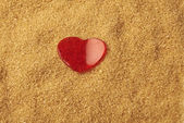 Valentines Day, red heart on brawn sugar — Stock Photo