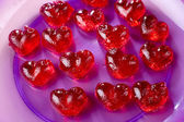 Valentines day, red sweet candies in heart shape — Stock Photo