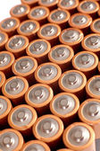 Gold batteries in rows — Stock Photo