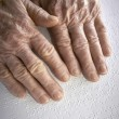 Old womans hands, reading a book with braille language — Stock Photo #39175795