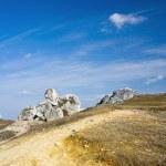 Dramatic sky over old limestone rocks — Stock Photo