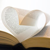 Book with pages folded into a heart shape — Stock Photo