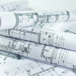 Stock Photo: Architect rolls and house plans