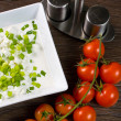 Bowl with fresh cottage cheese and chives — Stock Photo