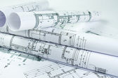Architect rolls and house plans — Stock Photo