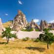 Ortahisar cave city in Capapdocia, Turkey - Stock Photo