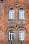 Old Brick Wall with White Windows — Stock Photo