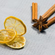 Cinnamon sticks, anise stars and sliced of dried citrus - Stock Photo